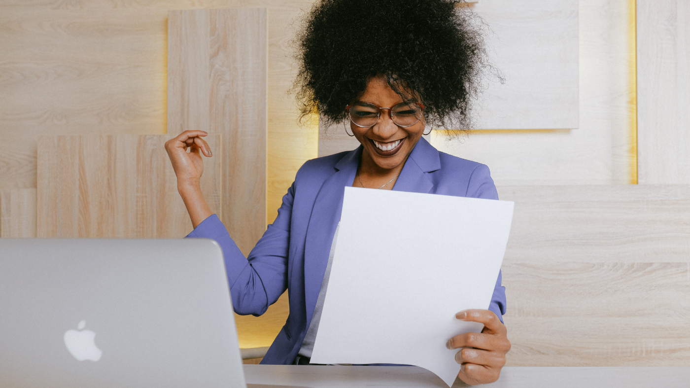 successful skincare business owner celebrating with laptop