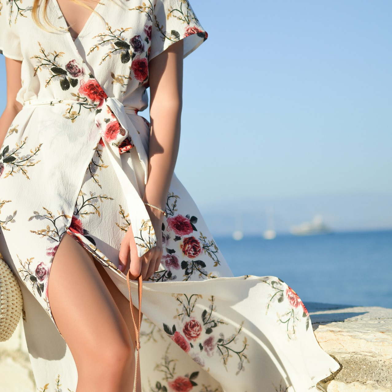 woman on the beach in a flowered dress