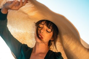 summer skincare tip--wear a big floppy hat like the woman in this picture