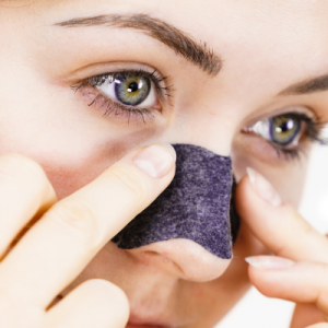 Healthy lymph can prevent clogged pores--woman with pore strip on nose